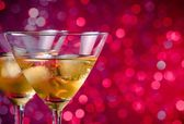 A pair of glasses of fresh cocktail with ice — Stock Photo