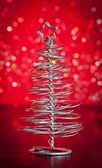 Close-up of metallic modern christmas tree on wood table — Stock Photo