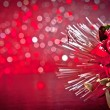 Christmas decoration on red bokeh background — Stock Photo