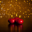 Red christmas candles on wood table golden bokeh background — Stock Photo
