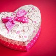 Gift box with ribbon on red background,concept of valentine day — Stock Photo #40482473