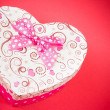 Gift box with ribbon on red background,concept of valentine day — Stock Photo