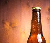 Bottle of fresh beer with drops, with space for text — Stockfoto