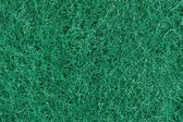 Green synthetic fabric texture — Stock Photo