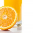 Detail of full glass of orange juice near half orange with space for text — Stock Photo #46567541