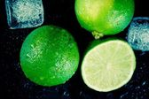 Top of view of fresh lime with ice cubes — Stock Photo