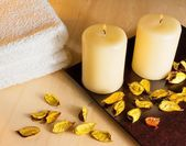 Top of wiev of spa massage border background with towel stacked, perfumed leaves, candles and sea salt — Stock Photo
