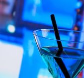 Detail of blue cocktail drink on a bar table with space for text — Stock Photo