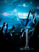 Blue cocktail drink on a disco table with space for text — Stock Photo