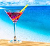 Red cocktail on wood table and space for text — Stock Photo