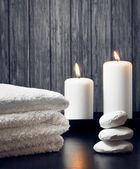 Spa massage border background with towel stacked.candles and stone — Stock Photo