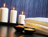 Spa massage border background with towel stacked.candles and sea salt — Stock Photo