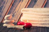 Spa massage border background with towel stacked stone and red candles — Stock Photo
