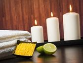 Spa massage border background with towel stacked candles and sea salt — Stock Photo