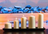 White candles on wood table — Foto de Stock