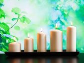 White candles on wood table — Stock Photo