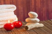 Spa massage border background with towel stacked stone and red candles warm atmosphere — Stock Photo