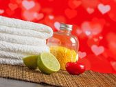 Spa massage border with towel stacked red candle and lime for valentine day — Stock Photo