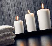 Spa massage border background with towel stacked and candles — Stock Photo
