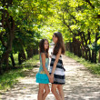 Two sisters in park — Stock Photo
