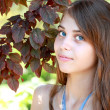Girl and leaves — Stock Photo #12166133
