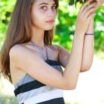 Girl in a garden — Stock Photo #12166169