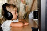 Child with headphones — Stock Photo