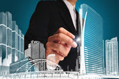 Business man or achitect draw the drawing of building or citysca — Stock Photo