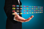Ręką człowieka biznesu przytrzymaj ikonę aplikacji — Zdjęcie stockowe