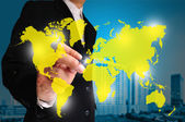 Global business concept with businessman that draws a world map — Stockfoto