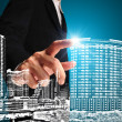 Business man or achitect touch the drawing of building or citysc — Stock Photo