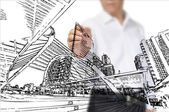 Business Man Drawing building and cityscape — Stock Photo