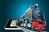 Vintage locomotive running through Touch Screen Tablet  — Stock Photo