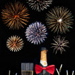 Stock Photo: Champagne and fireworks