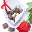 Chocolates and red rose — Stock Photo #19484101