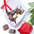 Chocolates and red rose — Stock Photo