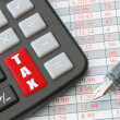 Calculater enter key with the word tax — Stock Photo