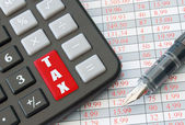 Calculater enter key with the word tax — Stockfoto