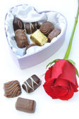 Chocolates and red rose — Stock fotografie