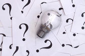 Light bulb and question mark — Stock Photo
