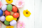Easter eggs with daisies around — Stock Photo