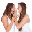 Two smiling young girlfriends — Stock Photo