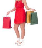 Jambes de femme et sacs à provisions — Photo