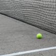 Tennis fence mesh and ball — Stock Photo