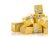 Pile of gold gift boxes — 图库照片