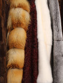 Background of various fur coats — Stock Photo