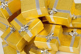 Close up of gold gift boxes — Stock fotografie
