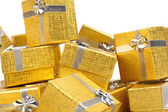 Gold gift boxes on white — Stok fotoğraf