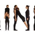 Black dressed people forming BEGINNER word — Stock Photo