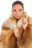 Young woman in luxury fur coat — Stock Photo